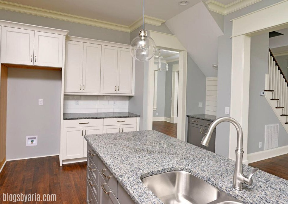 off white kitchen with gray painted island