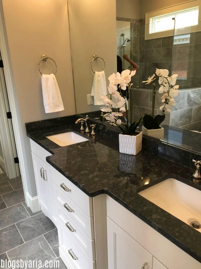 master bathroom with dark granite counters