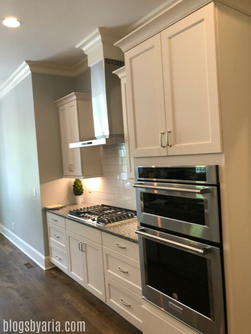 white kitchen with shaker style cabinets very clean look