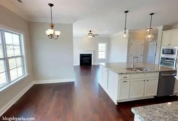 white kitchen with extra large kitchen island