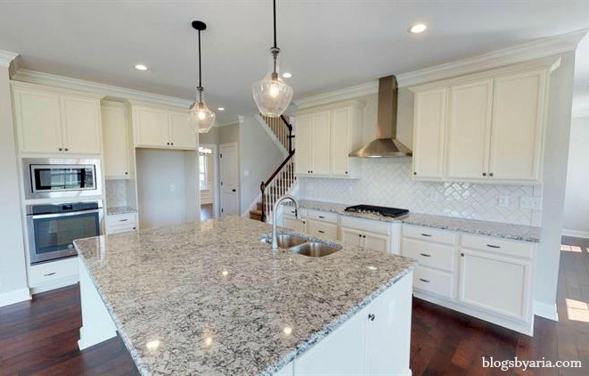 white kitchen with granite counter tops