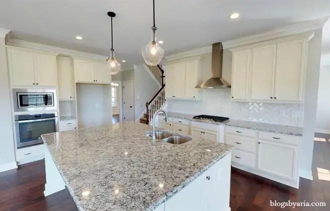 white kitchen with granite counter tops