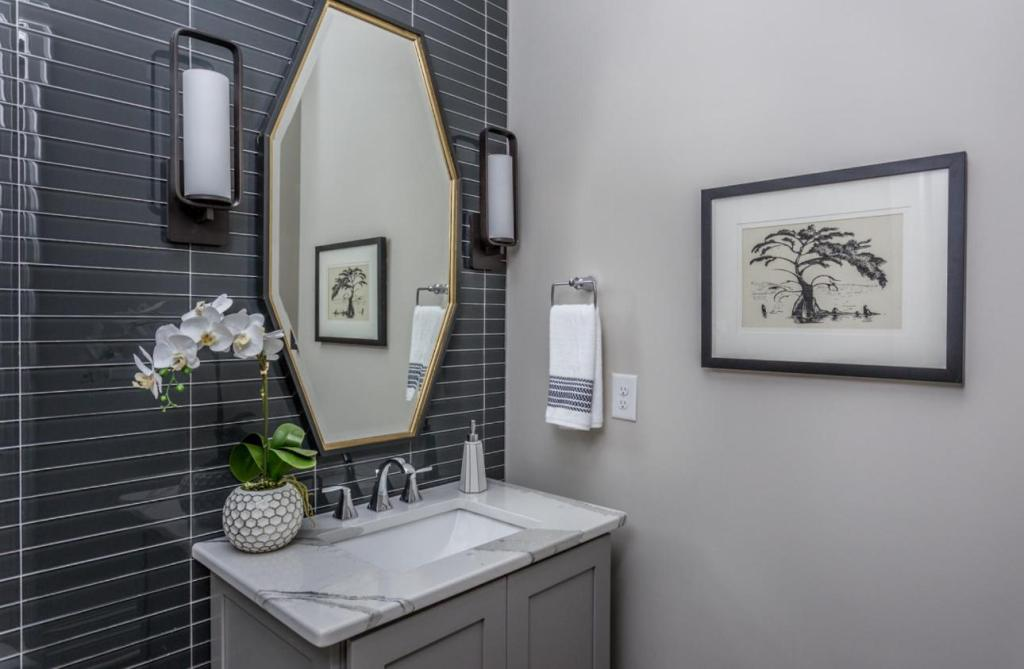 powder room with glass tile accent wall