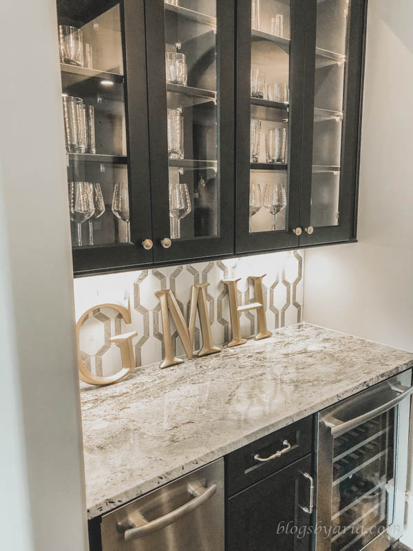 butler's pantry with glass cabinets for drinkware and wine fridge
