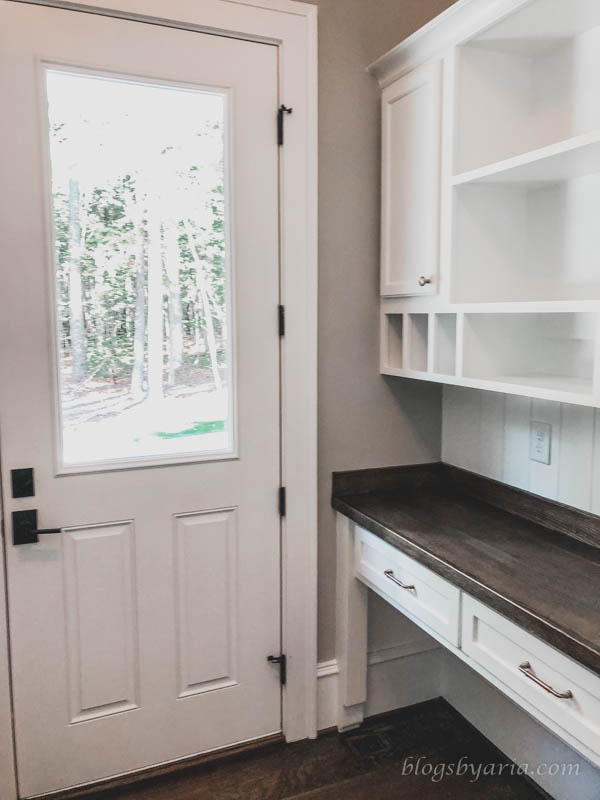 built in desk command center in the mudroom