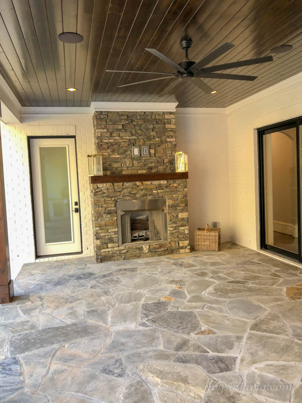 covered porch with fireplace and built in speakers