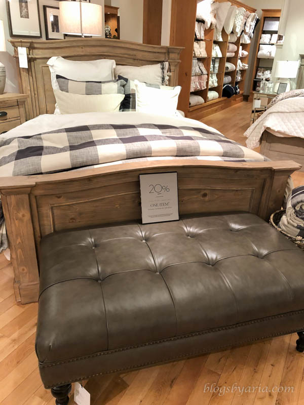 love this tufted leather ottoman as a bench for the foot of the bed
