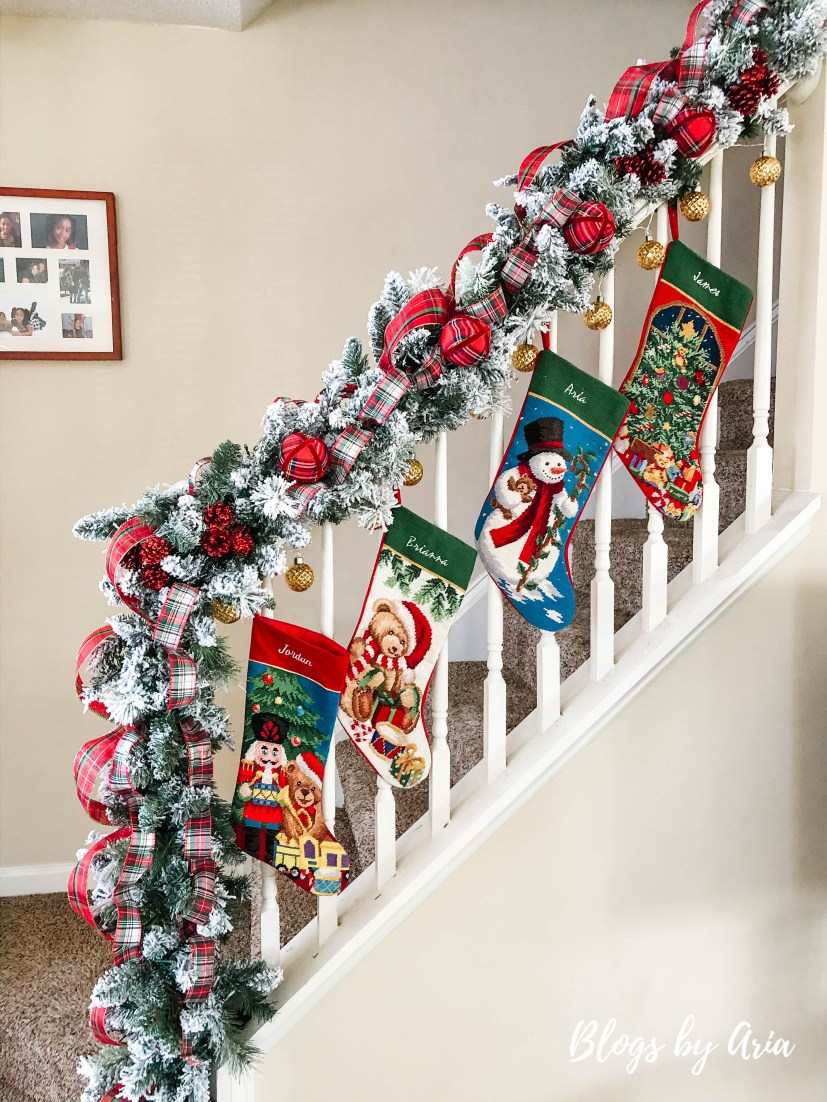 flocked stairway garland with stockings for Christmas