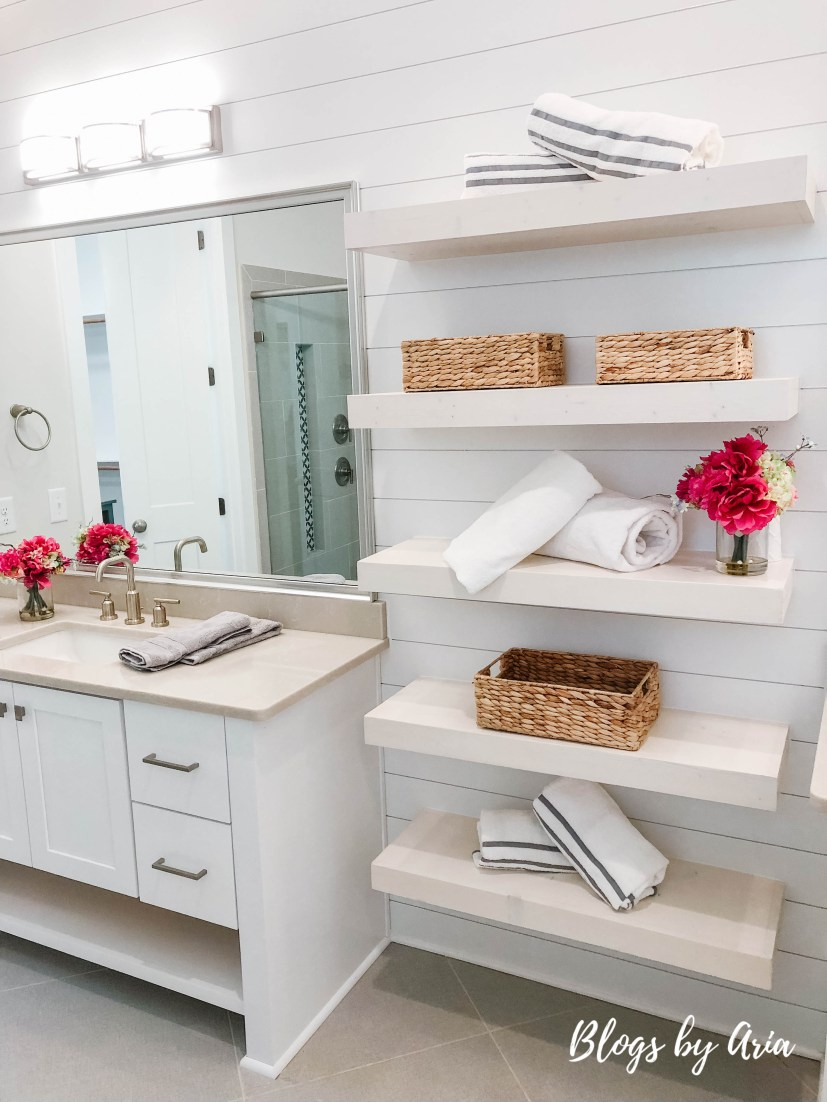 bathroom with open shelves