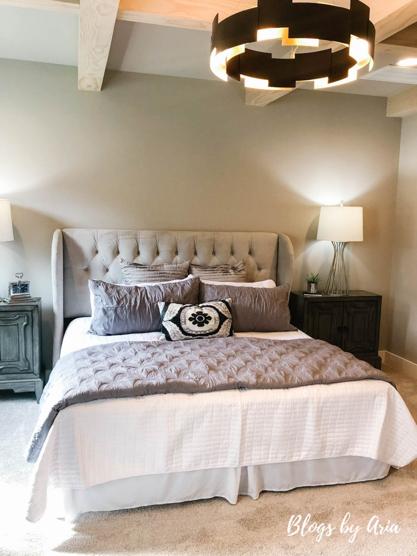 modern farmhouse bedroom with stained wood coffered ceilings
