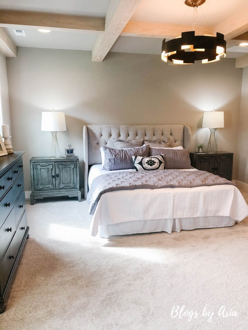 modern farmhouse bedroom with stained wood coffered ceilings and black lighting
