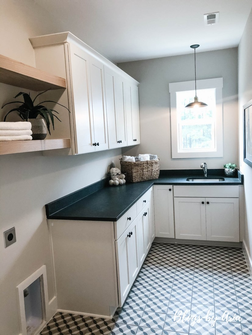 modern farmhouse laundry room with floating shelves