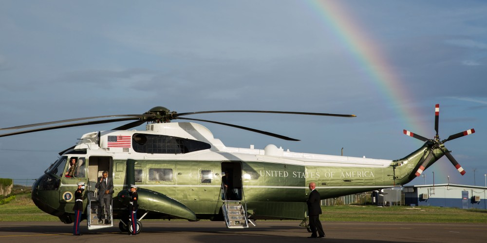 President Obama disembarks from a helicopter