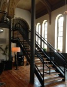 Stairs lead to an open loft-style second floor that also holds private massage rooms.