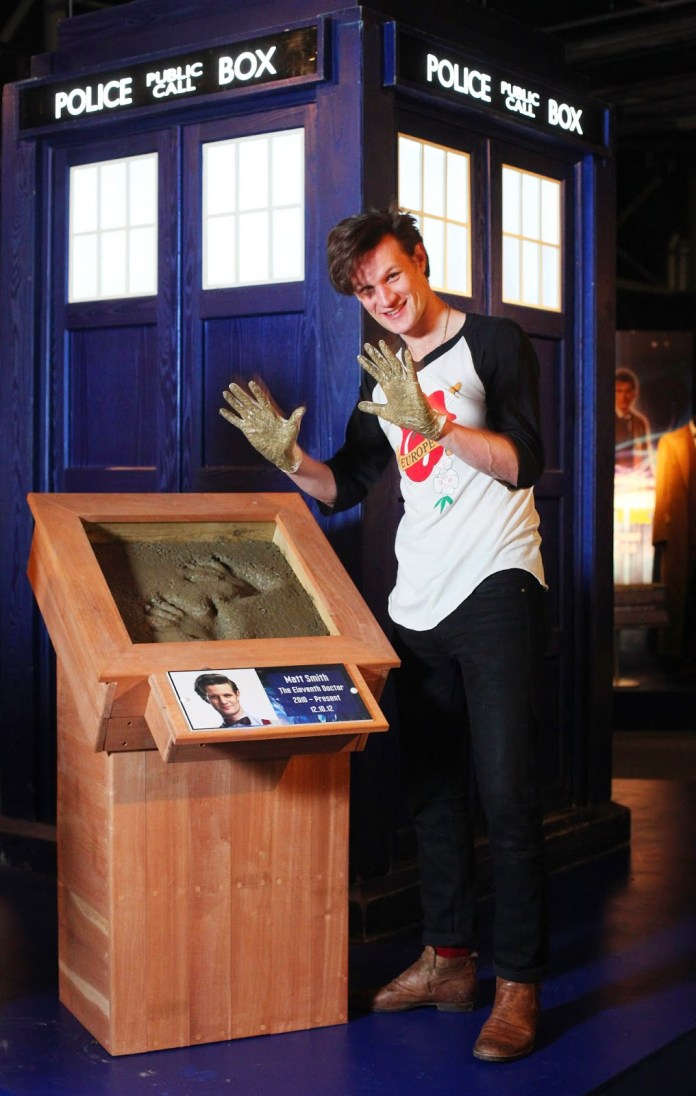 Matt Smith casts his hand prints in cement as he makes his first visit to The Doctor Who Experience in Cardiff Bay to unveils a new exhibit of iconic monsters and props from series 7. PRESS ASSOCIATION Photo. Geoff Caddick/PA