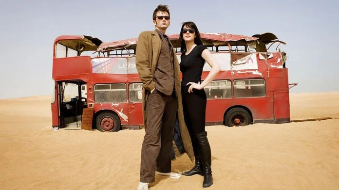 The Doctor (David Tennant) & Lady Christina (Michelle Ryan) & a Damaged London Bus - Doctor Who - Planet of the Dead - (c) BBC