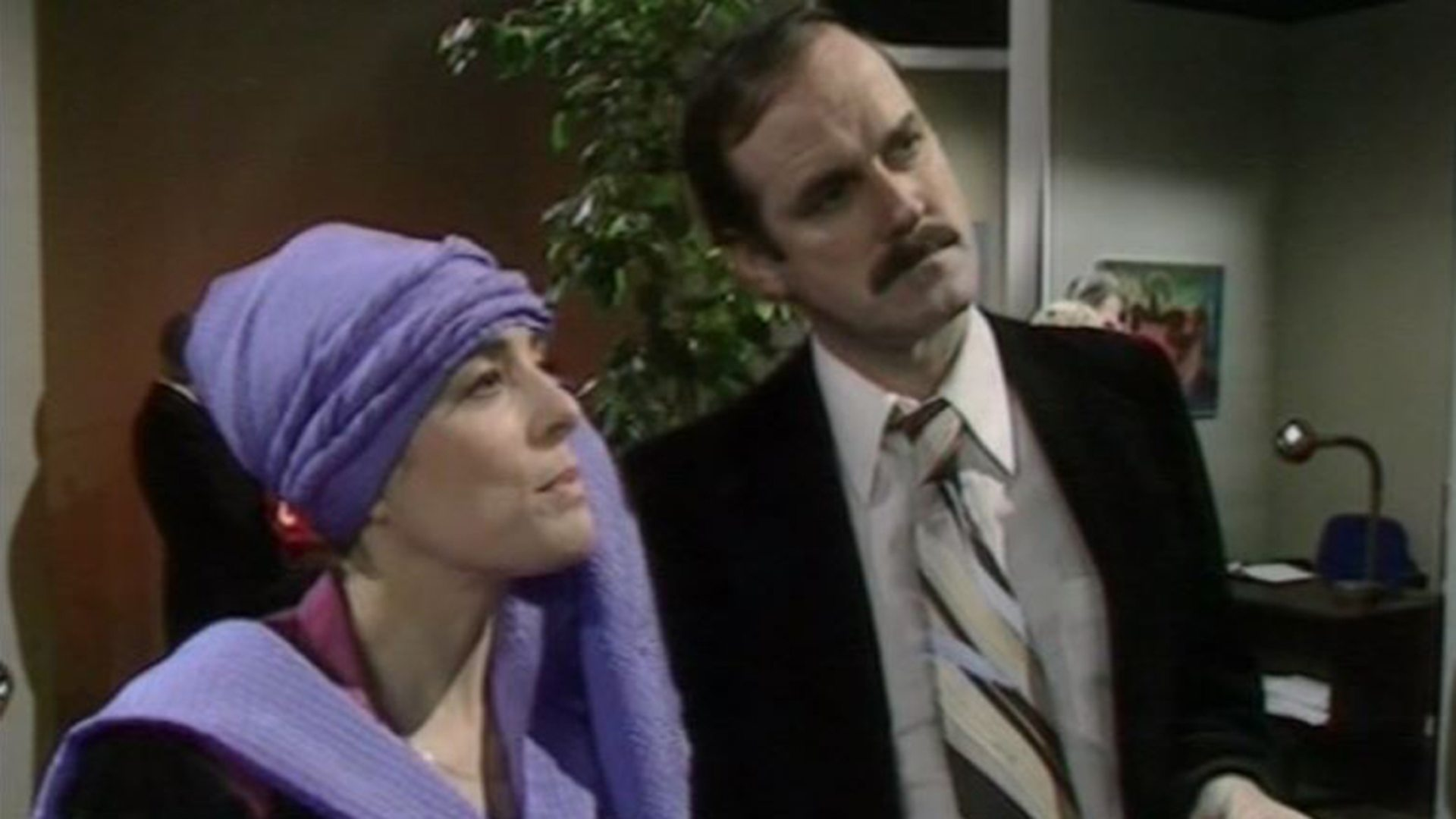 Image result for John Cleese and Eleanor Bron discussing the TARDIS as a piece of art in the Louvre