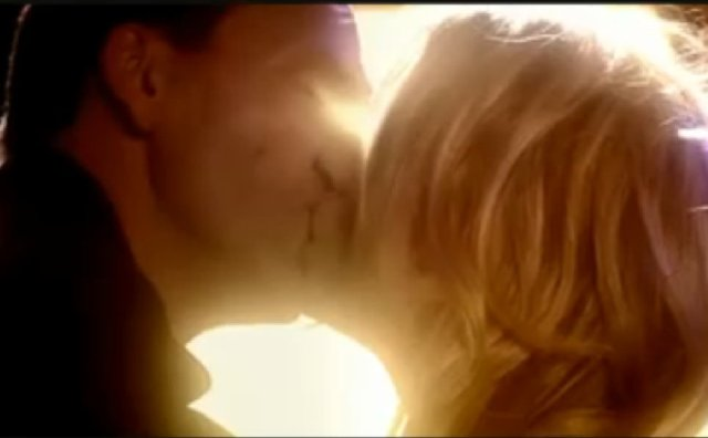 The Doctor and Rose kiss - Doctor Who - The Parting of the Ways (c) BBC