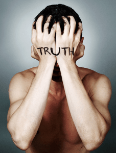"""man covering face with hands with """"truth"""" print"""