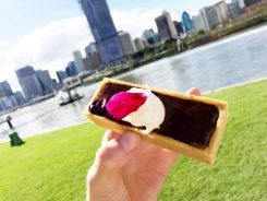 Salted caramel and hazelnut chocolate tarts with clotted Barambah Dairy cream, fresh berries from Cove at River Quay.