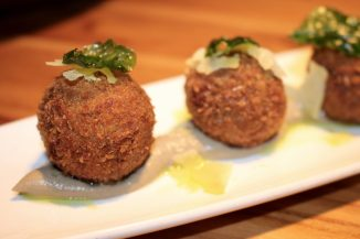 Mushroom and Truffle Arancini Balls with porcini puree, parmesan and basil