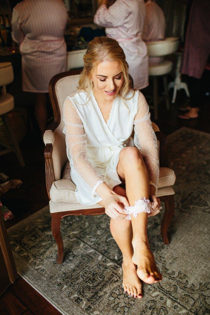 putting on my garter on wedding day