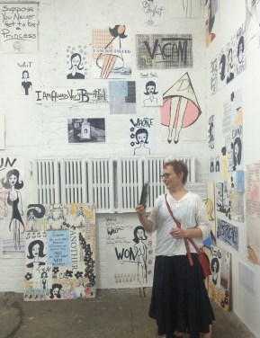 Pam Butler in front of the Good Girl Wall