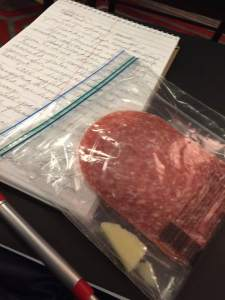 Barbara Custer enjoyed salami and cheese at the writing workshop.