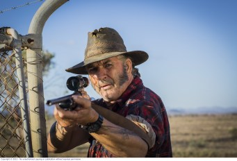 WolfCreek2_John Jarratt as Mick Taylor with gun 1