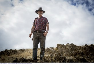 WolfCreek2_John Jarratt as Mick Taylor_ with gun _ from below 1