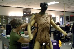 Fabricator Rachel Demski working on hair for suit.