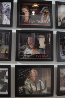 A wall of limited edition horror art and signed horror memorabilia 1