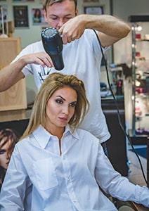 man-drying-womans-hair