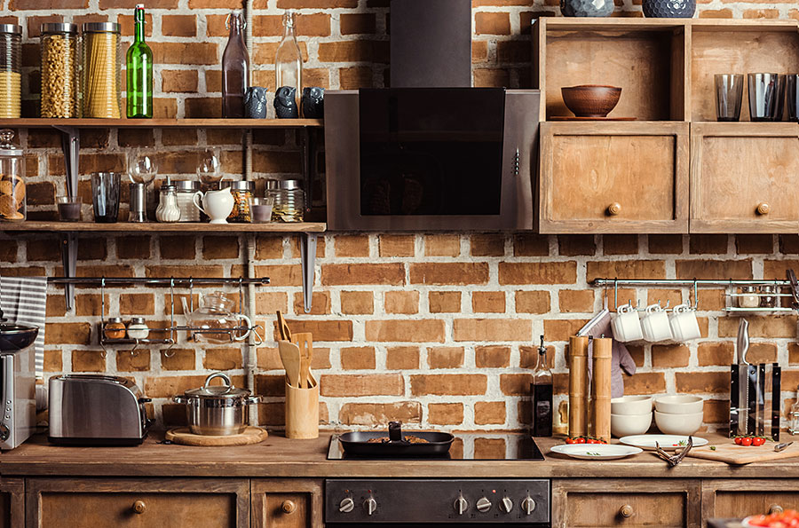modern rustic kitchen with exposed brick wall