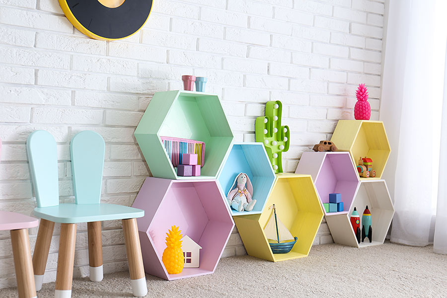 child room interior with colorful hexagonal stacked shelves