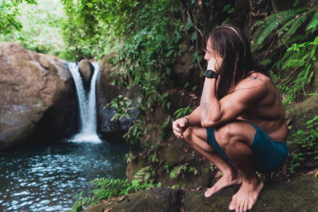 man enjoying scenic Costa Rican waterfall