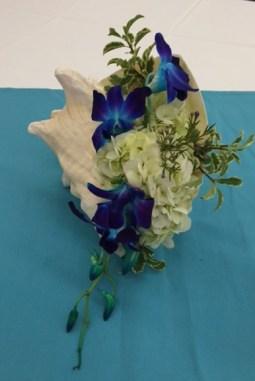 blueflowersinshell