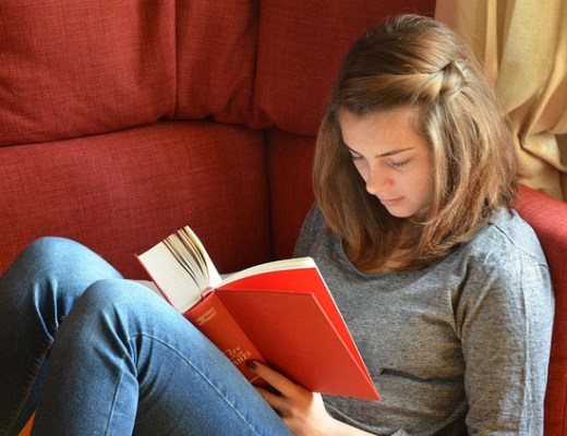 Girl reading book GCSE