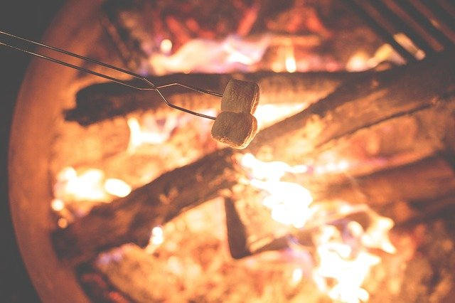 marshmallows toasted on an open fire