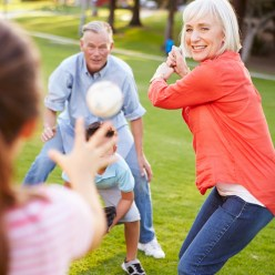 Family Playing baseball together.