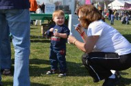 A mother and son play with bubbles, one of the free gifts for event attendees.