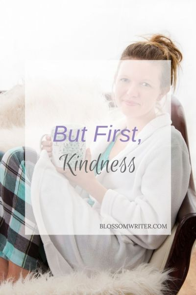 "Melissa McMillan sitting on a couch in her pajamas, holding a mug of coffee. The text reads, ""But First, Kindness."""