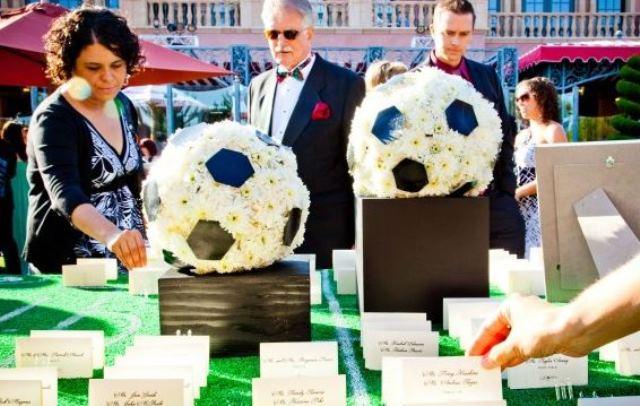 Love these flower soccer ball wedding centerpieces