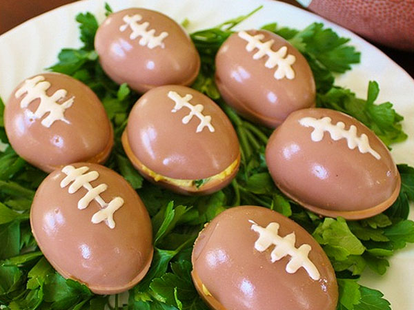 Football shaped appetizer eggs