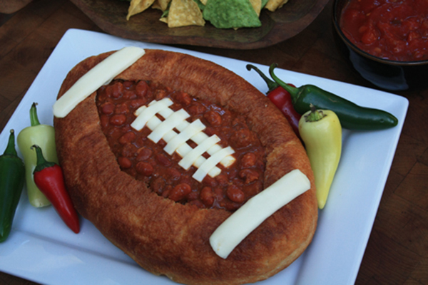 Football shaped bread bowl and chil for football party