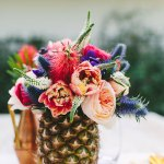 Beautiful Pineapple Centerpiece- Love the flowers!