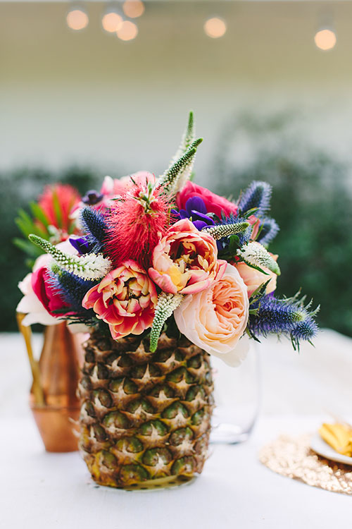 Beautiful Pineapple Centerpiece- Love the flowers! - See More Lovely Pineapple Party Ideas At B. Lovely Events!