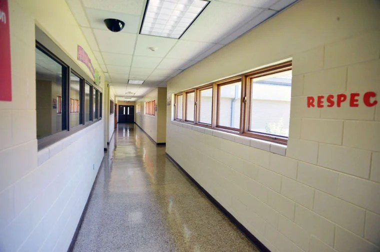 Anniston school board eliminates six jobs at three campuses  votes     Anniston Middle School hallway