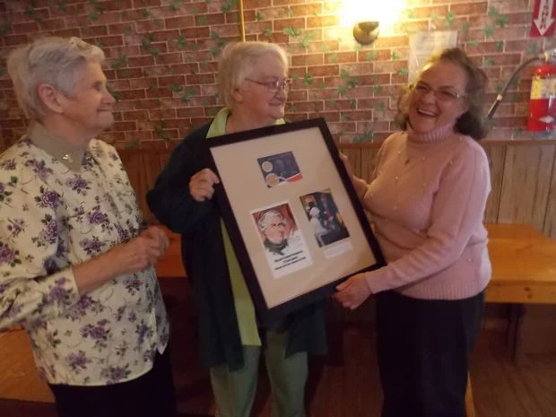 From the Auburn Citizen:  New Summerhill town historian Patricia McCloy, right, smiles during a presentation by the Cayuga Owasco Lakes Historical Society as retiring town historian Florence Lansdowne, left, and society President Joyce Hackett Smith-Moore look on. (Photo by Jessica Soule)