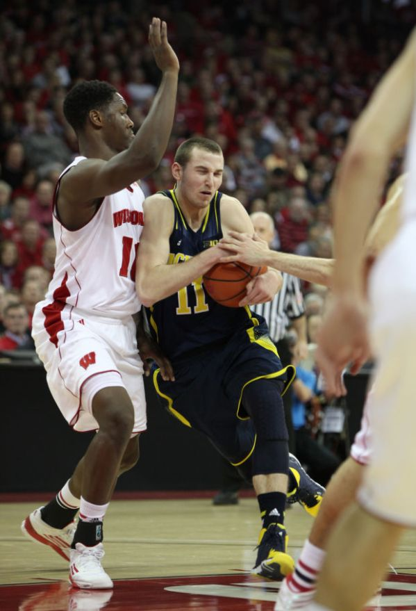 Badgers men's basketball: Michigan hangs on to hand UW ...